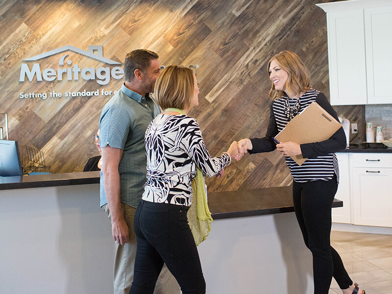 Couple greeted at a Meritage office
