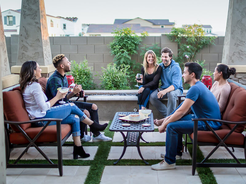 Friends having a good time together on an outdoor patio