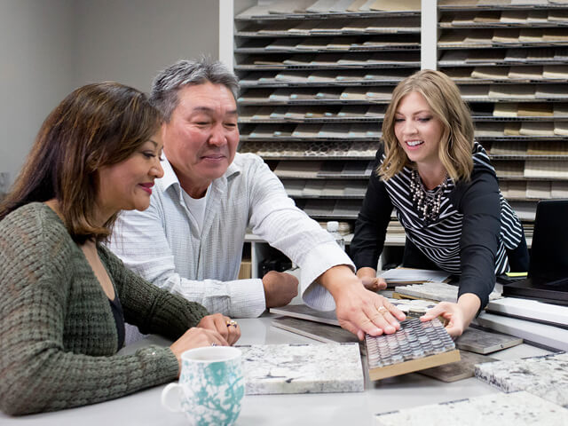 Man feels the texture of a tile sample provided by a salesperson