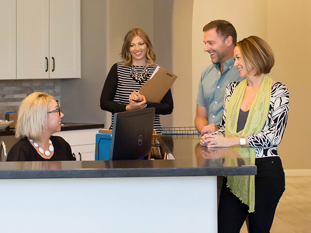 Meritage team providing support to customers in office