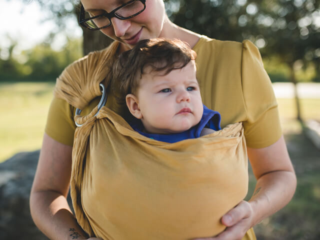 Woman holding baby in a baby sling