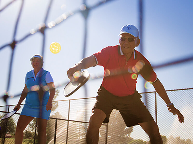 Couple playing paddle tennis