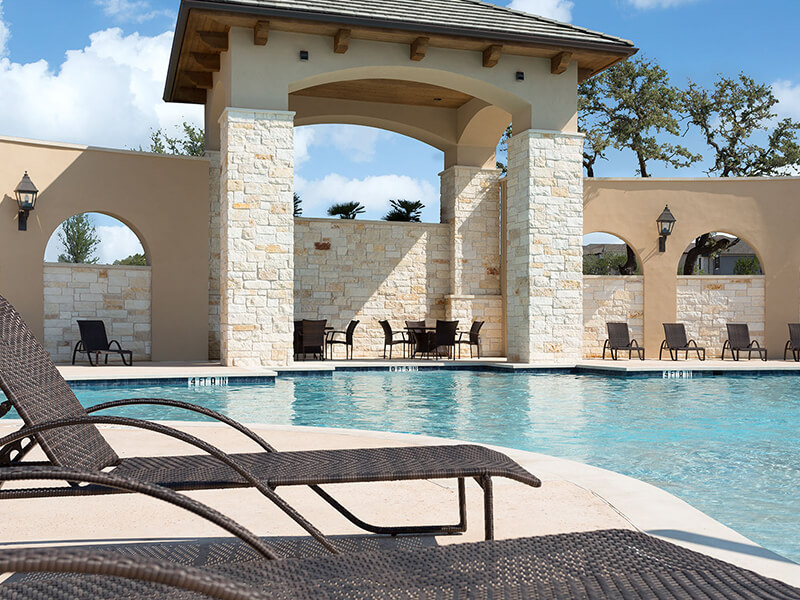 Pool with stone wall and pillars