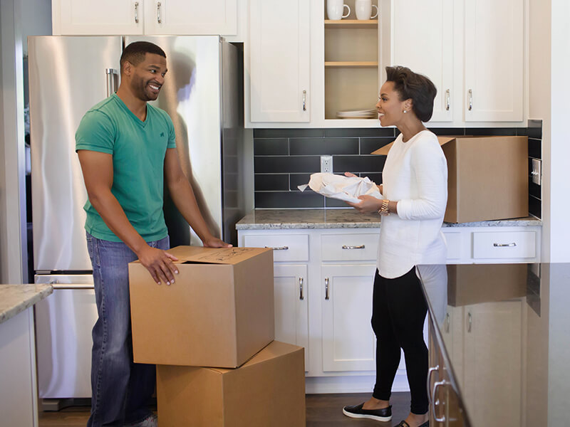 Couple unpacking boxes during their move