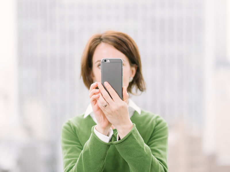 Woman taking a photo from her phone