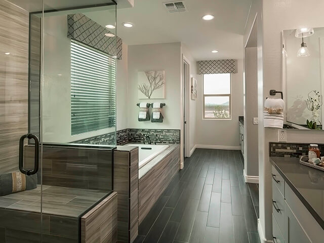 Modern bathroom with large tub and dark floors