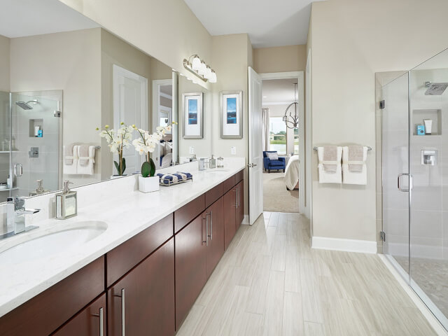 Bathroom with light wooden floors and shower