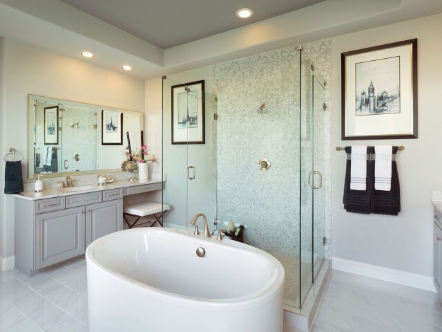 Bathroom with glass shower and oval tub
