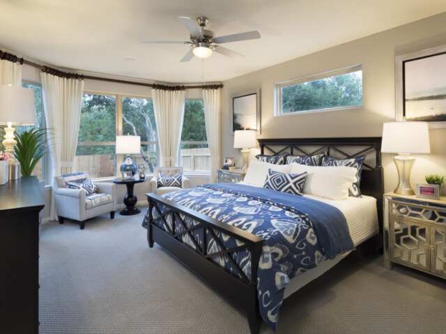 Bedroom with blue carpet