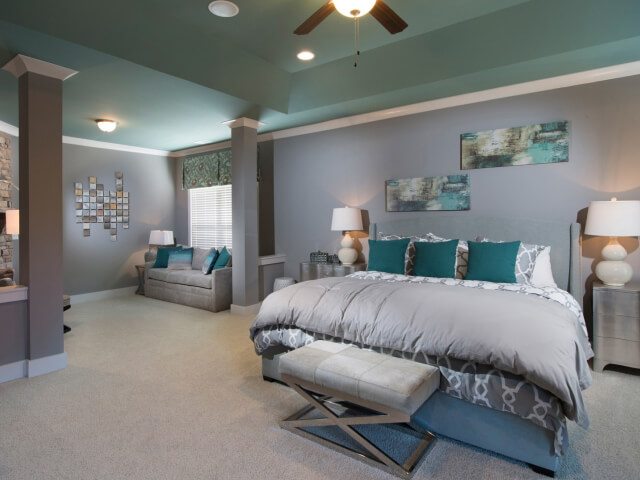 Bedroom with beige carpet and aqua ceilings