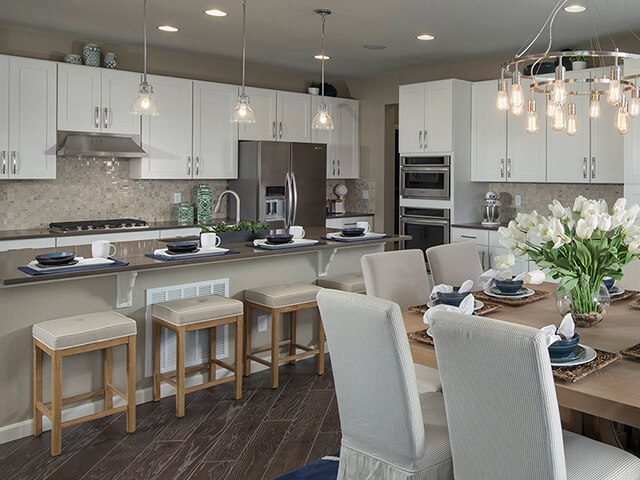 Kitchen with white cabinets and dining table