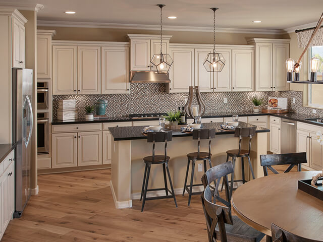 Kitchen with granite island and light hardwood