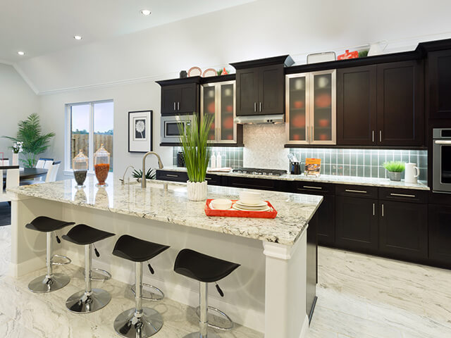 Modern kitchen with black bar stools and white granite