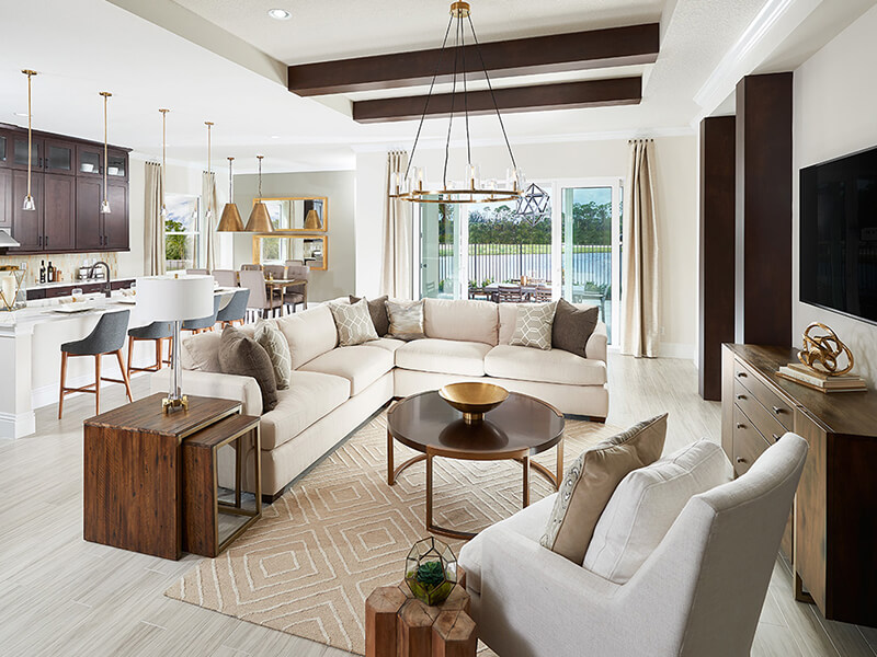 Living room with large white couch and wooden coffee table