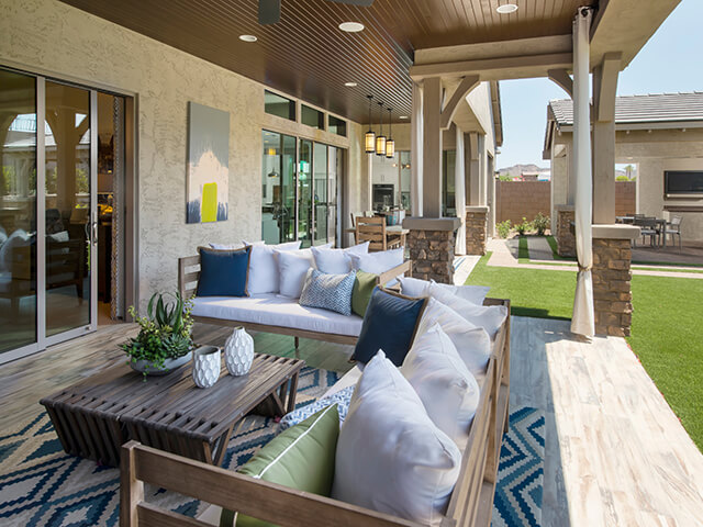 Covered outdoor patio with wooden coffee table