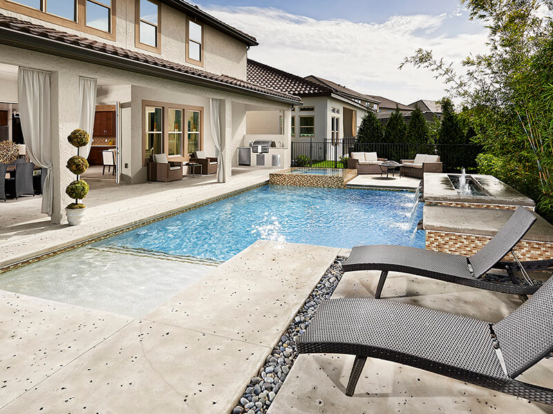 Outdoor pool area with hot tub